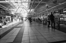 walking-through-the-bus-station-leeds